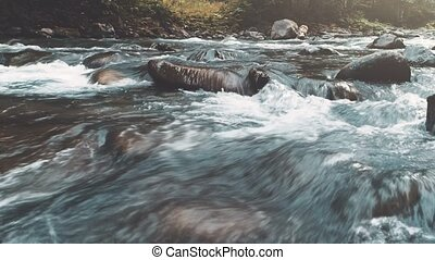 Mountain river in autumn forest. Water close-up - Mountain...