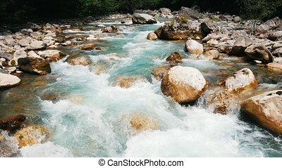 Mountain river, landscape of nature. Pure clear water moves among large stones