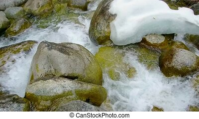 mountain river stones - fast mountain stream among the...