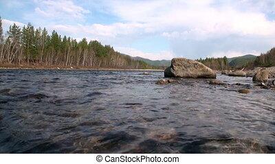 Mountain river Temnik at border of Baikal State Nature...