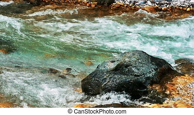 Mountain river with big stones
