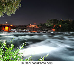 mountain river with bridge at the night time