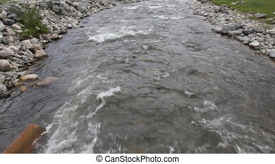 mountain river with clear water flowing from slope - river...