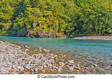 Mountain river with pebble and stones
