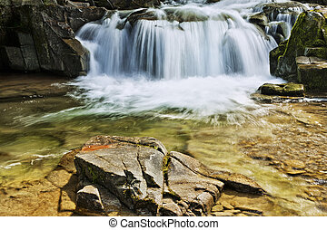 Mountain river with waterfall