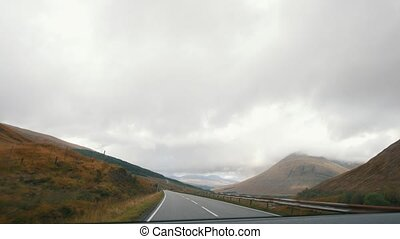 Mountain road in Scotland highland, pov