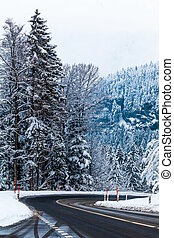 Mountain road in winter. Winter landscape. Winter road and trees covered with snow