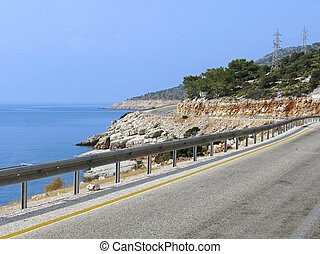 mountain road - winding road between the sea and rocks