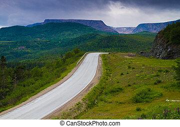 Mountain road - Beautiful road through mountain range in...