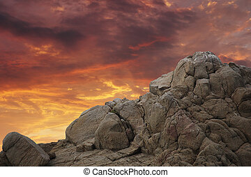 Mountain rock over sunset