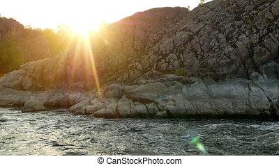 Mountain rock river sun