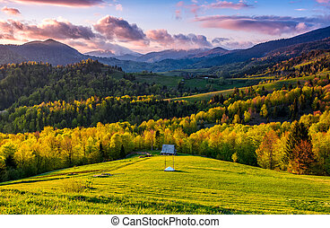 mountain rural area in springtime at cloudy sunset -...
