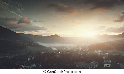 Mountain settlement foggy weather aerial view - Mountain...