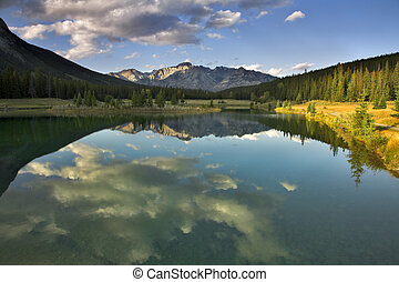 Mountain silence. - Mirror reflection of the sky and clouds ...