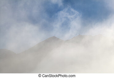 mountain silhouettes in morning fog