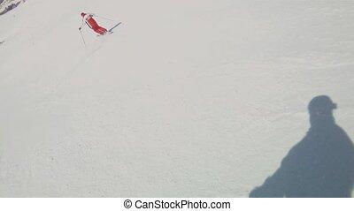 Mountain-skier. - Skier down the mountain road.