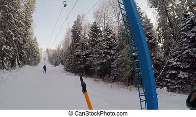 Mountain-skier sliding up with the rope tow