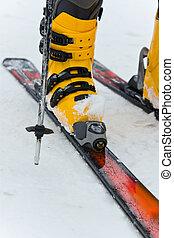 Mountain-skiing boot on snow