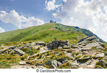 Mountain slope with ruins of observatory on top in Carpathians