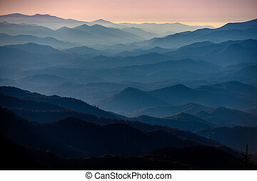 Mountain Slopes with Fall Leaves Stretch out at sunset