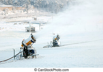 Mountain snow blowers - A pair of snow blowers blowing snow...