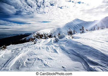 Mountain snow-capped peaks with snow on textured