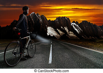 mountain stage - a racing cyclist stands on the street...