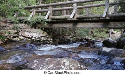 Mountain Stream Under Hiking Bridge - A mountain stream, the...