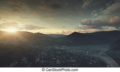 Mountain suburban town cottage sunrise aerial view -...