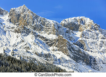 Mountain summits against blue sky - a wintertime view from...