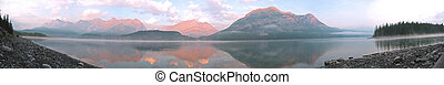 Mountain Sunrise - A morning panoramic shot of mountains and...