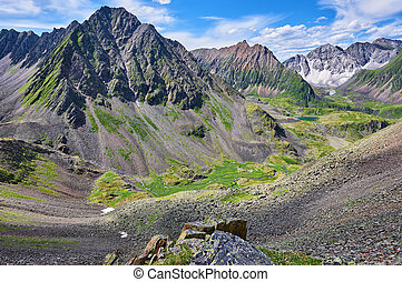 Mountain top and valley of brook in the Siberian Alps . Eastern Siberia. Russia