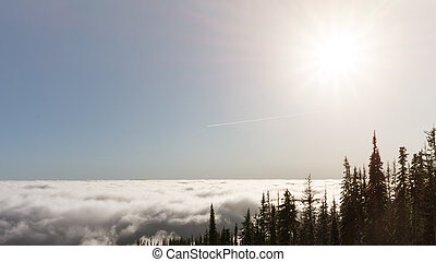 Mountain top view above the clouds