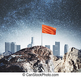 Mountain top with red flag