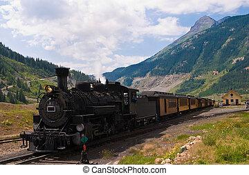 The historic narrow gauge Durango-Silverton steam locomotive approaches Silverton, Colorado.