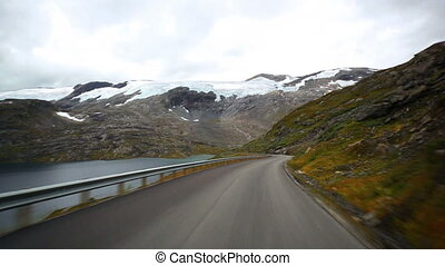 Road mountain travel in Norway. Fast motion effect.
