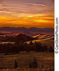 Mountain Twilight - Smoke from forest fires help create a...