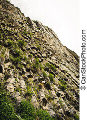 Mountain unique geological formation called Symphony of Stones. Basalt rock organ. Eco tourism. Nature background. Adventure holiday. Armenia, Garni. Travel vacation. Climbing tourism concept.Caucasus