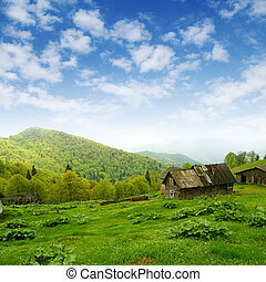 mountain valley and old wood shack