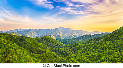 Mountain valley at sunset - Panoramic view of a mountain...