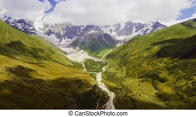 mountain valley at the foot of Mt. Shkhara. Upper Svaneti,...