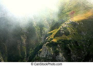 mountain valley in the mist, Bucegi Mountains, Romania