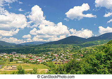 Mountain valley on a background of the rural landscape