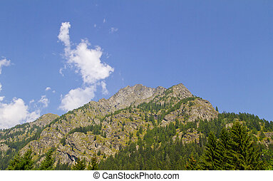 Mountain - View of the top of a big mountain under blue sky