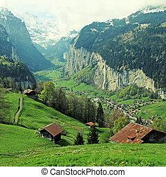 mountain village in the Alps, Switzerland .