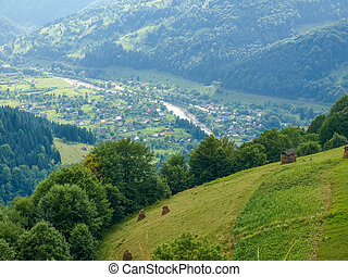 Mountain village in valley in the Carpathian Mountains