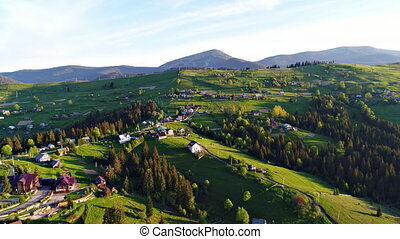 Aerial view of the village Yablunytsia in Carpatian mountains, landscape with a bird's eye view, drone camera.