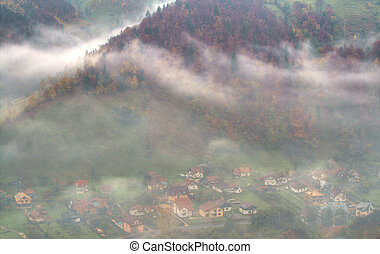 Mountain village through the clouds