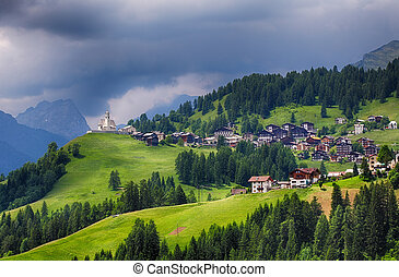Mountain village with house in Dolomites
