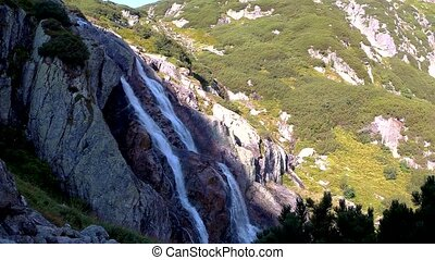 Mountain waterfall with cold water